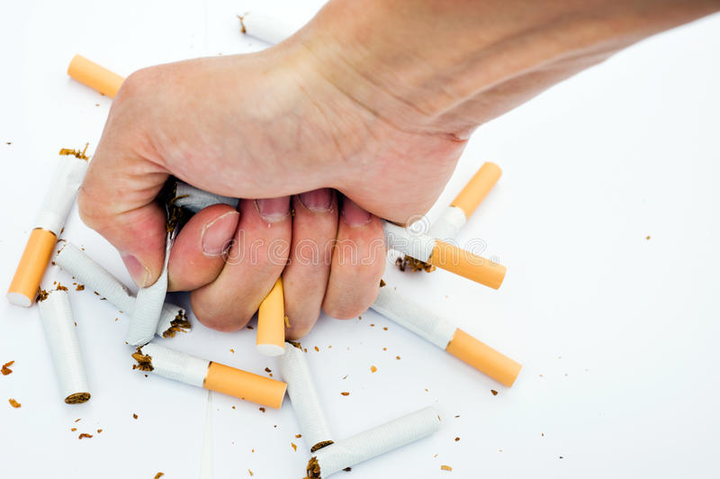Stop Smoking. Man trying to give up smoking stock images