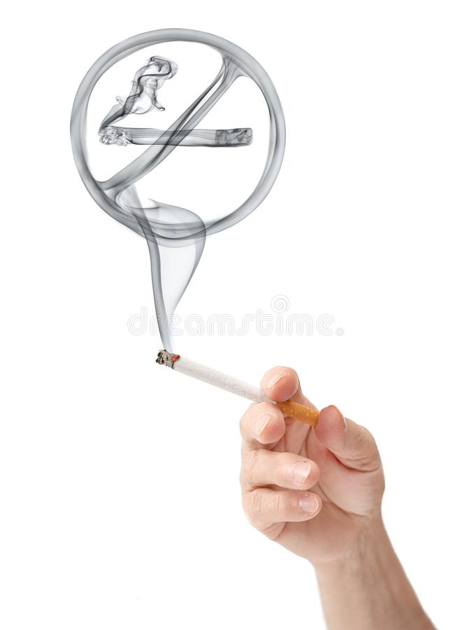 Stop smoking. No smoking sign rising from a cigarette held in hand of an elderly woman, isolated on white background stock photography