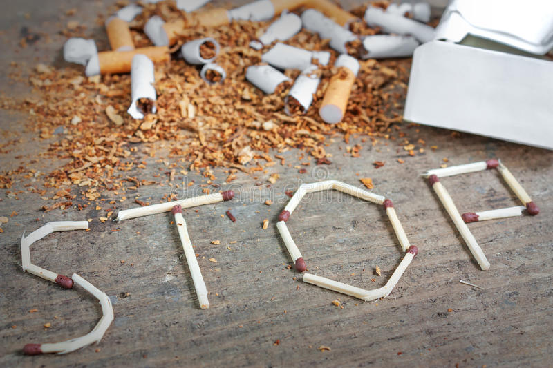 Stop smoking background with broken cigarettes and tobacco stock image