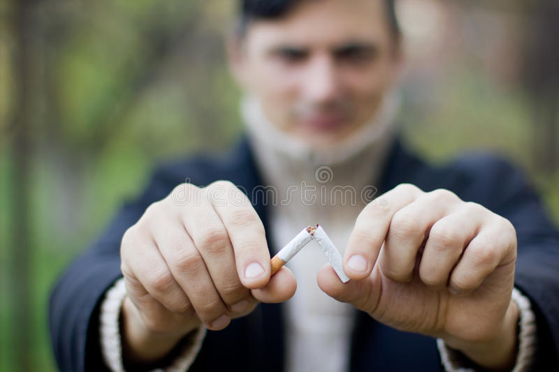 Stop smoking. A broken cigarette stock photos