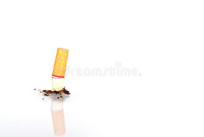 Stop smoking. Cigarette on the ground isolaed as stop smoking concept royalty free stock image