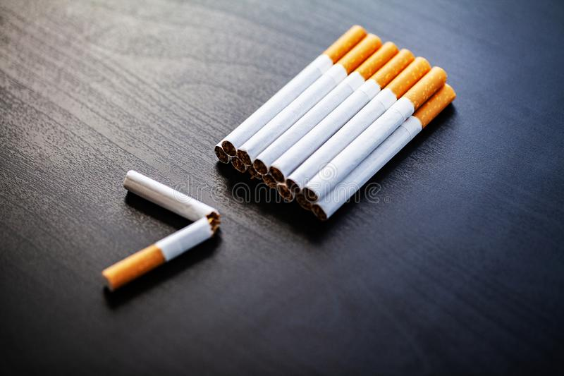 Stop smoking concept on background with broken cigarettes. Heap royalty free stock photography