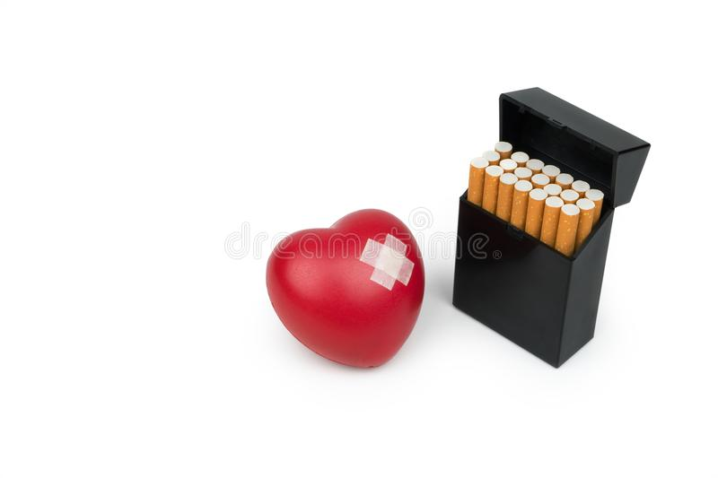 Red heart symbol with adhesive plaster and the cigarette pack stock image