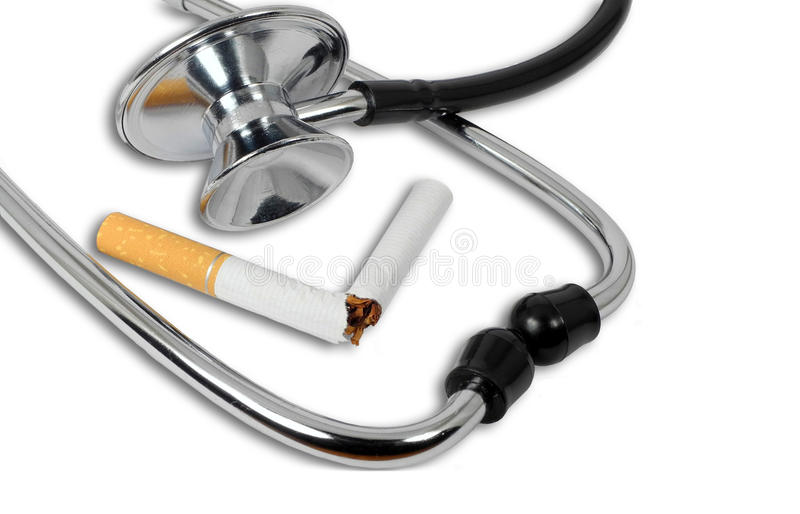 Stop smoking concept. Stethoscope and broken cigarette as stop smoking concept stock image
