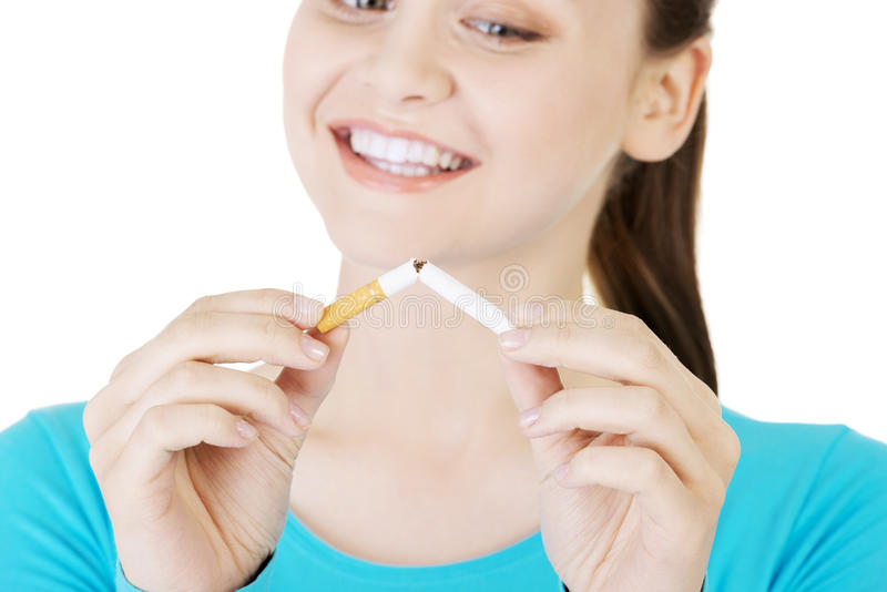 Stop smoking concept. Young woman with broken cigarette. Stop smoking concept stock photos