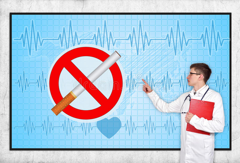 Stop smoking. Doctor pointing to screen with stop smoking symbol royalty free stock images