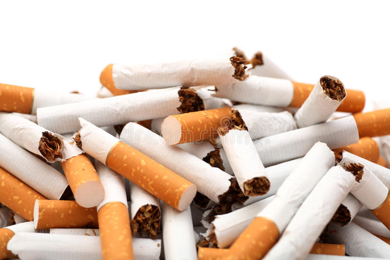 Stop Smoking!. Heap of broken cigarettes against white background. Close-up royalty free stock photos