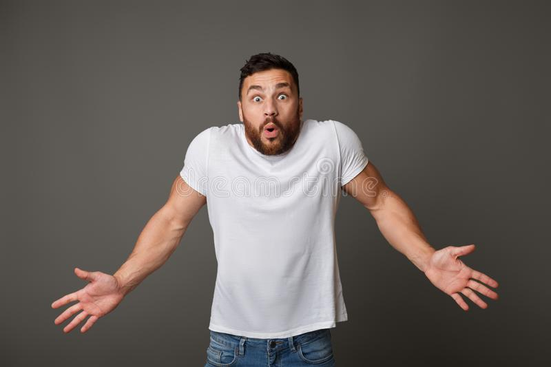 Confused unaware man raising palms in surrender royalty free stock photos