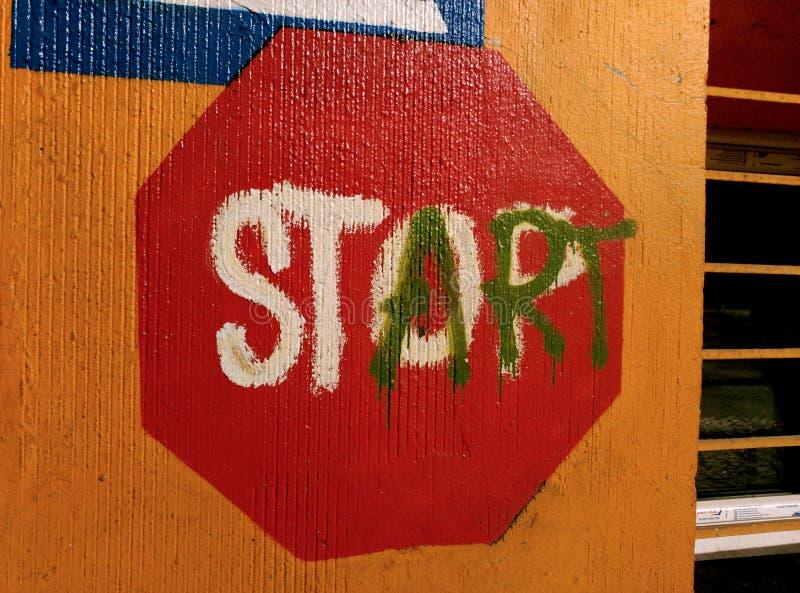 Stop Start Street Art Sign. Shot in Berlin Germany royalty free stock image