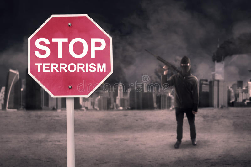 Stop Terrorism text with male terrorist royalty free stock photos