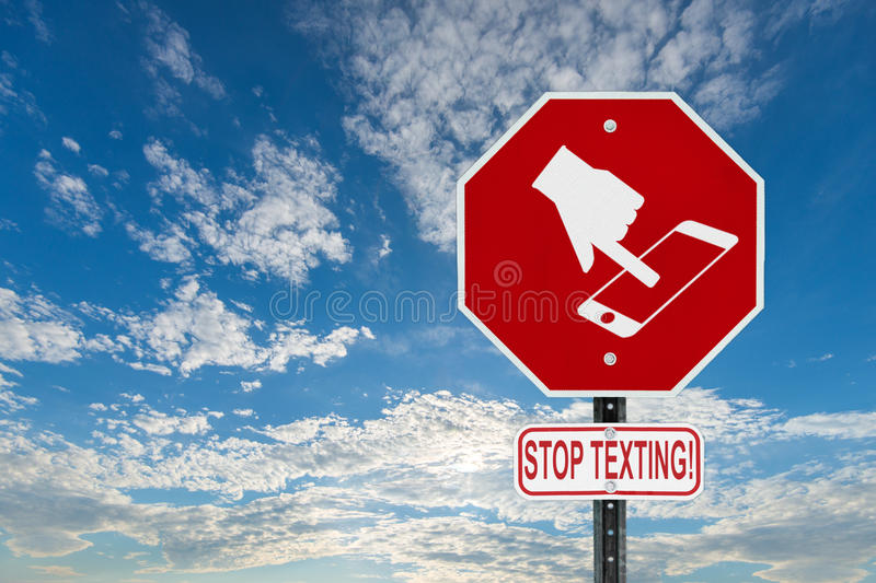 Stop Texting Icon Sign - Blue Sky with Clouds stock photography