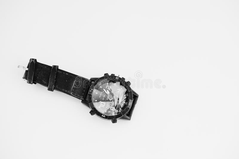 Stop the time concept. Crashed watches isolStop the time concept royalty free stock photography
