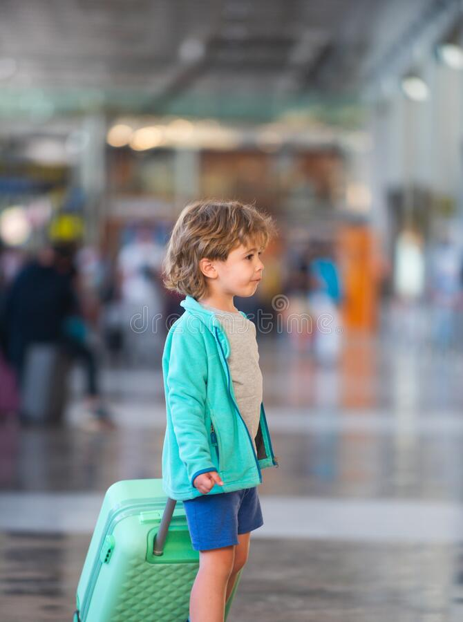Stop travel. Closed borders. Prohibited Flights. Canceled flights. Child with a suitcase at the airport. Stop travel. Closed borders. Prohibited Flights stock photography