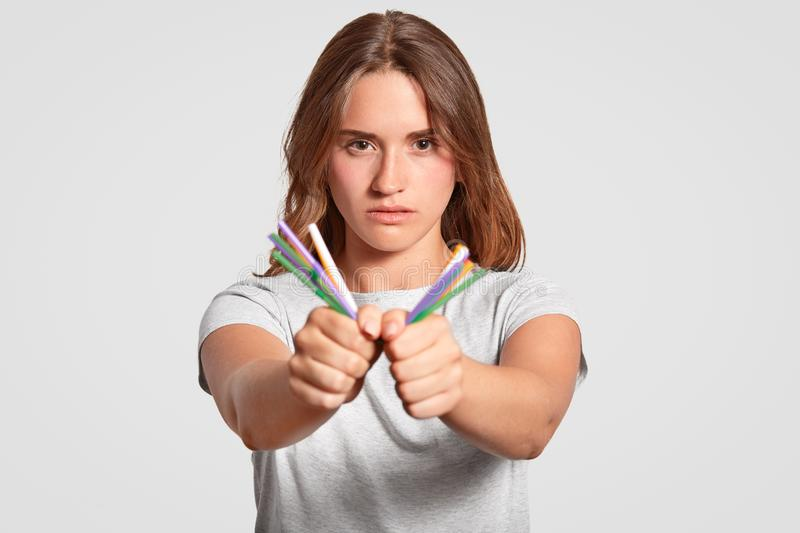 Stop using plastic straws. Serious lovely female being against of using plastic drinking straws, supports cleanliness of nature an. D environment, dressed stock image