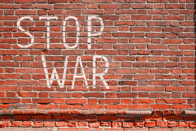 STOP WAR. Antique wall from brick with STOP WAR graffiti royalty free stock photography