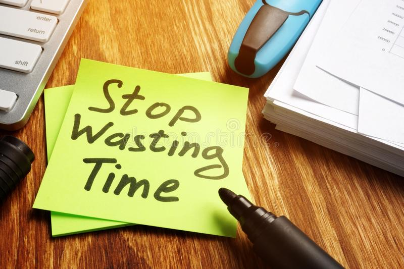 Stop wasting Time notice on the piece of paper royalty free stock image