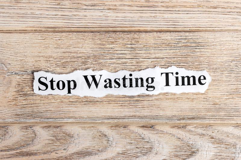 Stop Wasting Time text on paper. Word Stop Wasting Time on torn paper. Concept Image royalty free stock photo