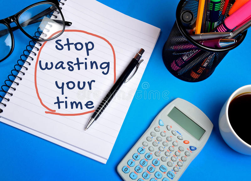 Stop wasting your time word. On notebook royalty free stock photos