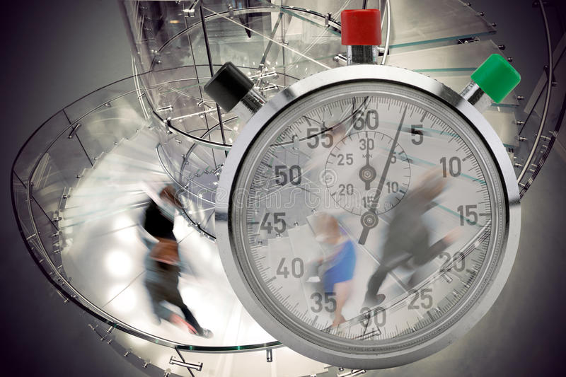 Stop watch and people in staircase. People rushing up and down modern transparent spiral staircase, with stop watch in foreground stock photo