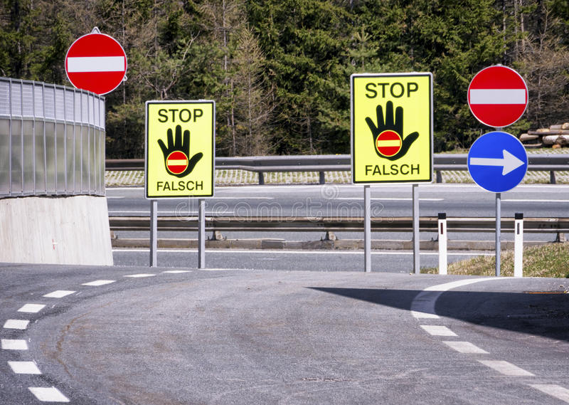 Stop - wrong way. Stop signs - wrong way - in austria at a highway stock images