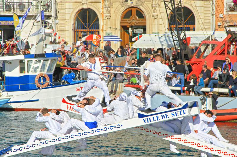 Stopover in Sete – Maritime Traditions Festival. SETE, FRANCE - March 26, 2016: Water Jousting performance during Stopover in Sète – Maritime royalty free stock photos