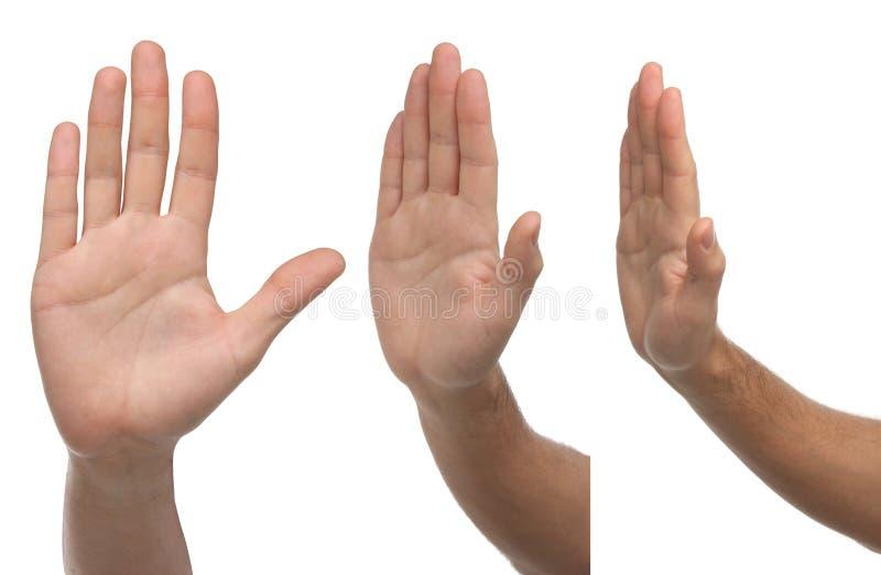Stopp Tre olika manliga handtecken royaltyfri bild