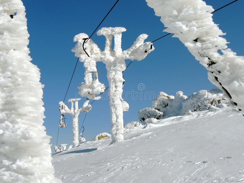 Stopped ski lift in frost stock photos