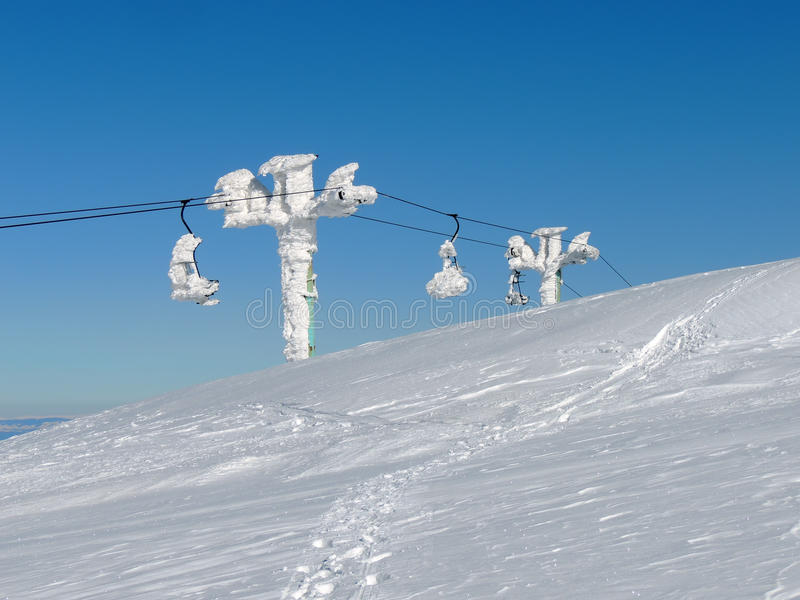 Stopped ski lift in frost royalty free stock photography