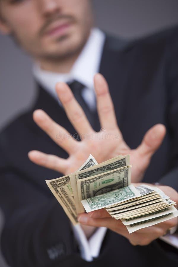 Stoppen Sie Bestechungsgeld lizenzfreie stockfotografie