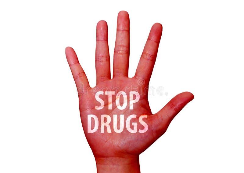 Stoppen Sie die Drogen, die auf eine Hand geschrieben werden stockfoto