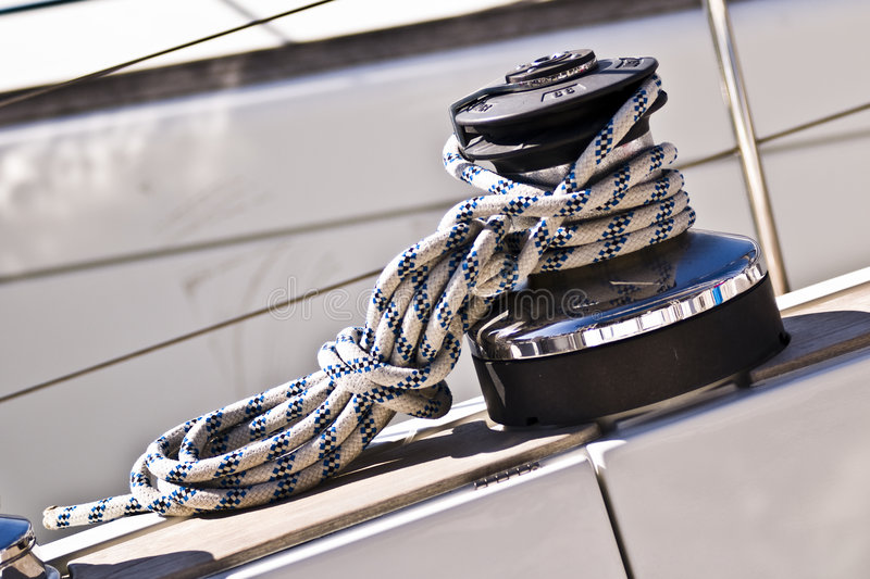 Stopper and Ropes. Winch and Ropes on a sailboat - Italy 2007 stock photos