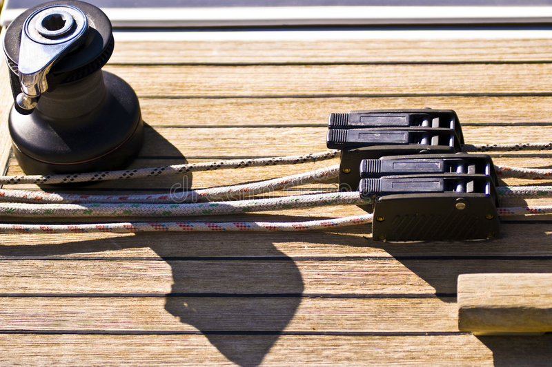 Stopper, Ropes & Winch. Stoppers, ropes and winch on a wooden deck of a sailboat - Barcolana / Sailboat Race - Trieste, Italy 2007 stock images