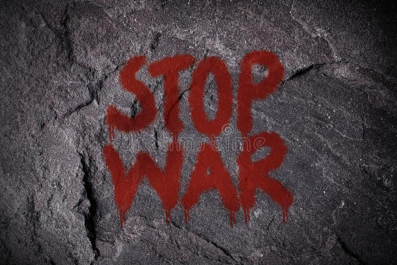 Stoppkriggrafitti på väggen royaltyfri fotografi