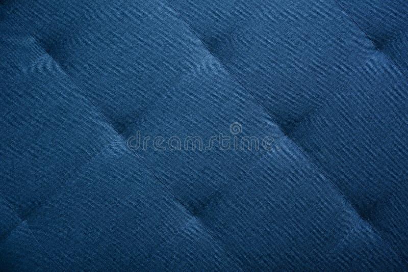 Stoppning från soffan arkivfoto