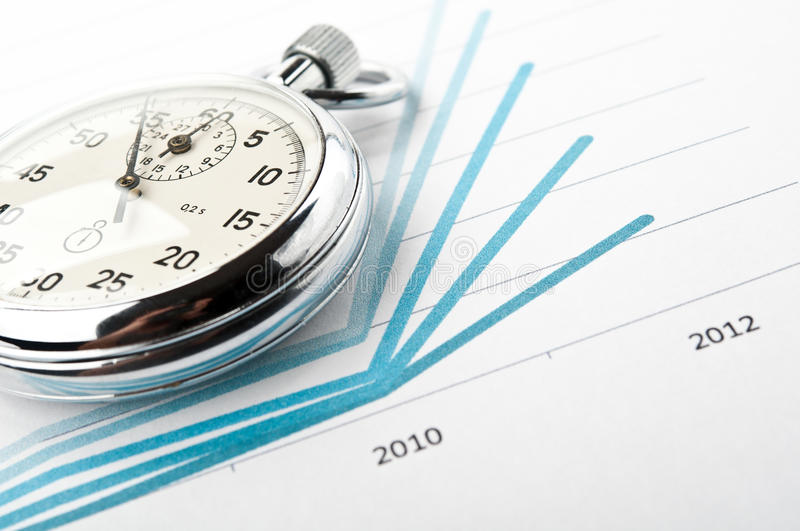 Stopwatch and financial growth chart. On the table in the office stock photography