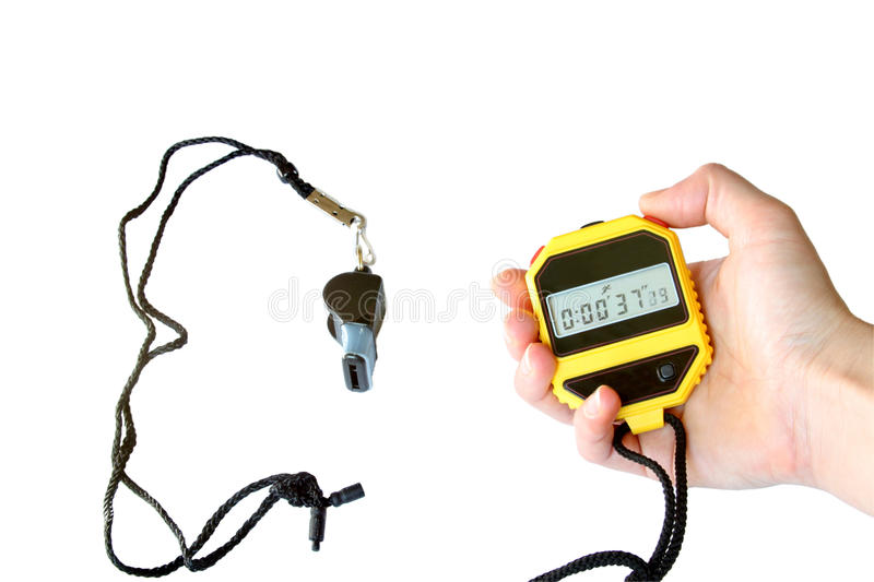 Stopwatch in the hand and sports whistle stock photos
