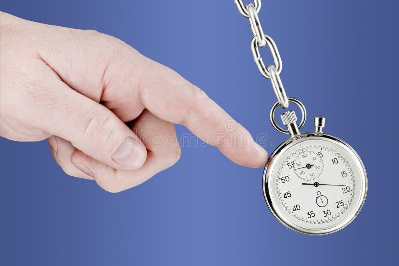 Stopwatch pendulum and hand royalty free stock photo