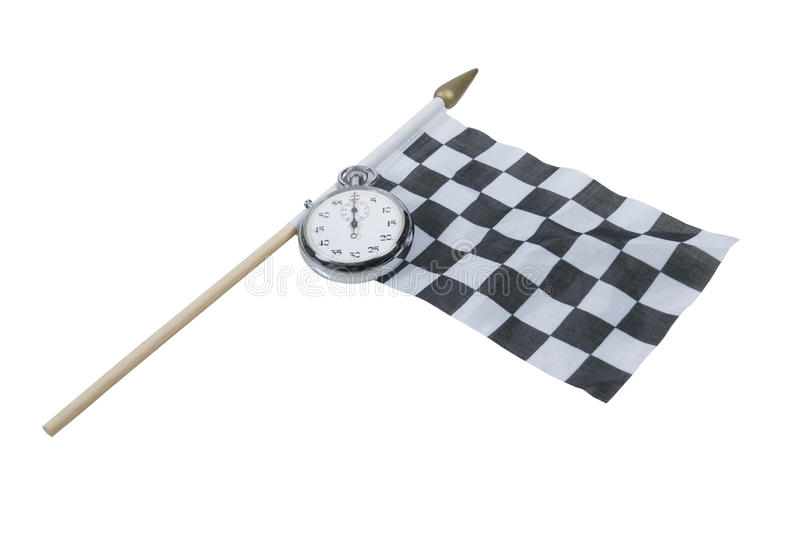 Stopwatch and Racing Flag. Silver stopwatch on a black and white racing flag - path included royalty free stock photo
