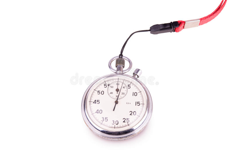 Stopwatch on white background. Old metalic stopwatch on white background closeup stock photos