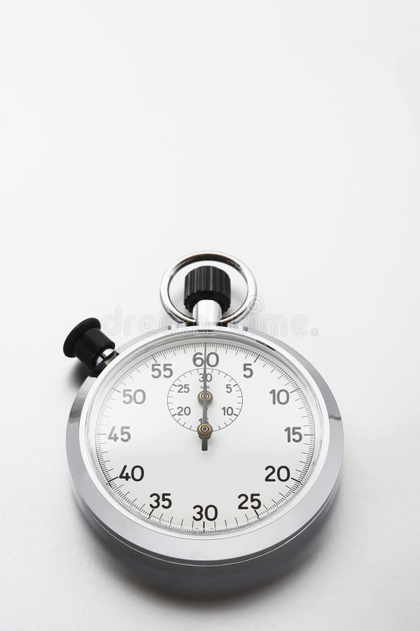 Stopwatch on white background studio shot royalty free stock images