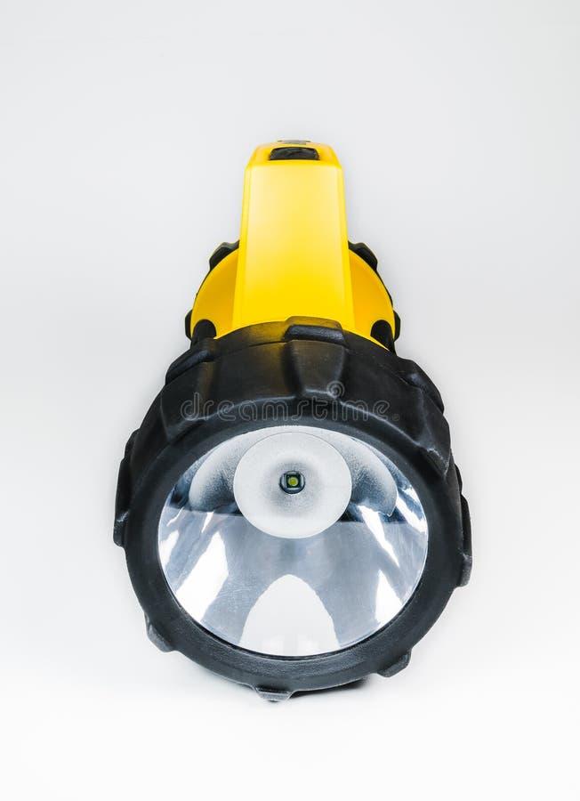 Stor gul ficklampahand - som rymms med den justerbara vinkeln som isoleras på vit bakgrund royaltyfria bilder