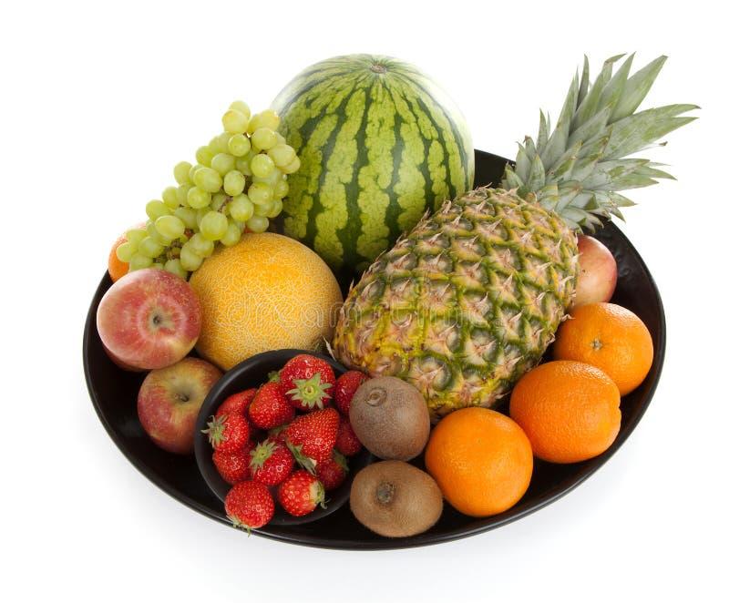 Stor platta med massor av sunda frukter royaltyfri foto