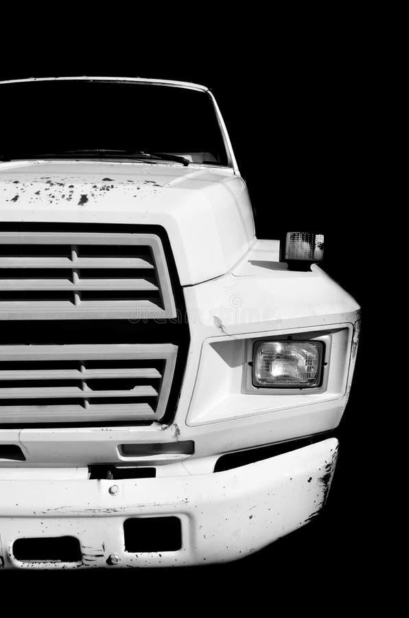 Stor vit lastbil på svart royaltyfria foton