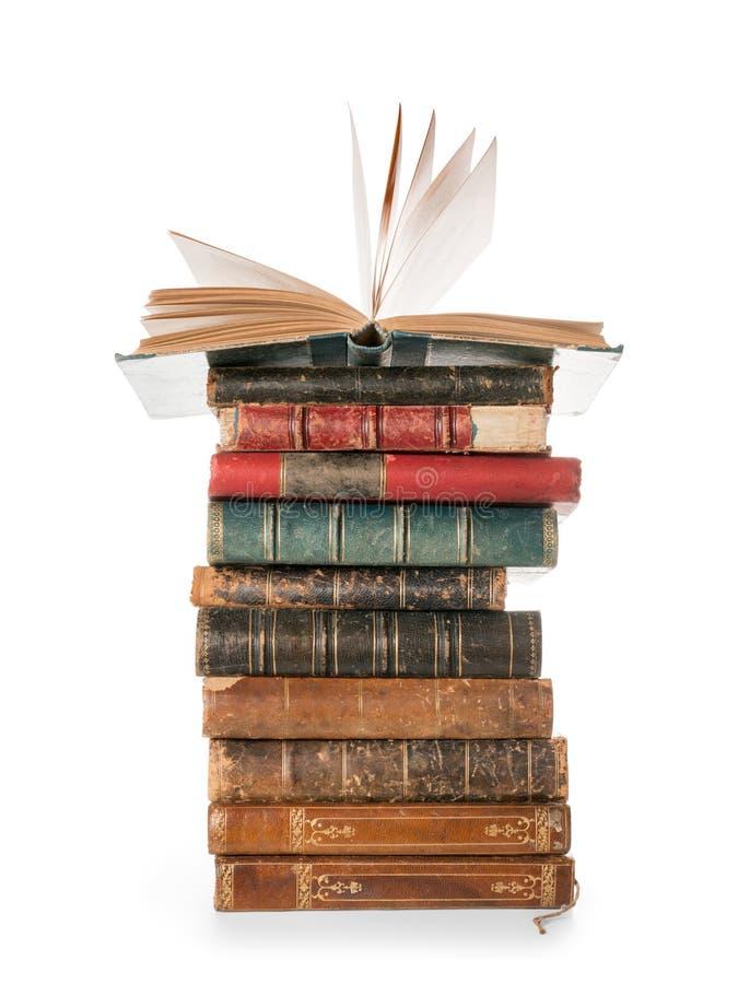 Stora böcker traver med den enkla öppna boken som isoleras med urklippbanan royaltyfri foto