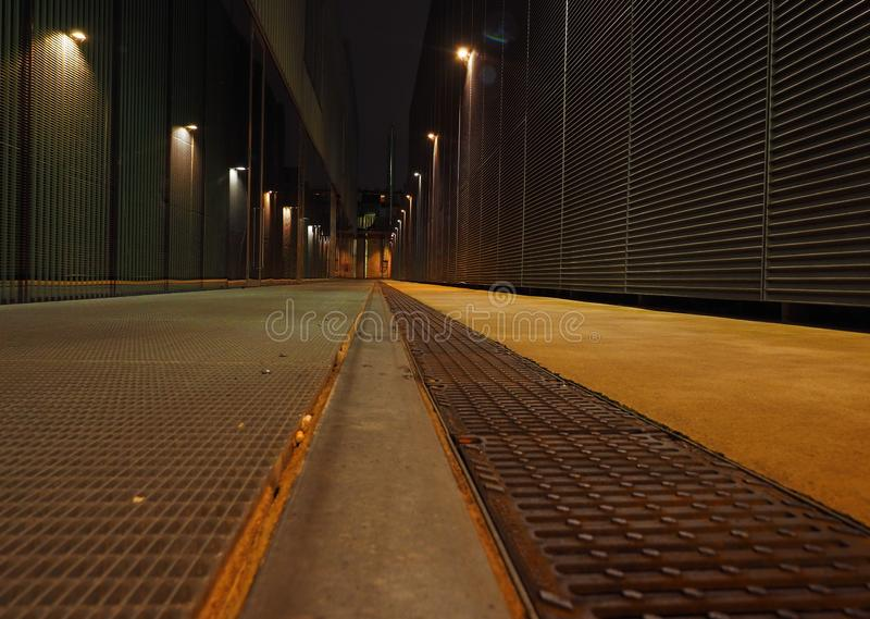 Storage area metal alley in the night royalty free stock photography