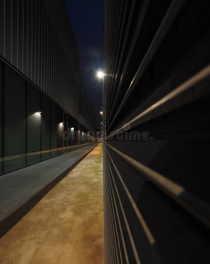 Storage area metal alley in the night royalty free stock photo
