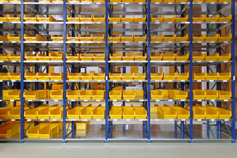 Storage bins. Storage trays and bins in distribution warehouse stock photo
