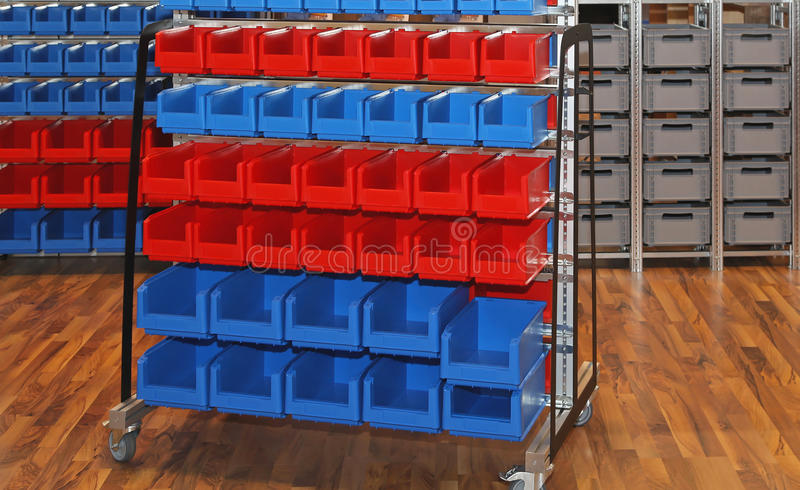 Storage Bins and Tubs. Sorting Tubs and Bins Storage Cart in Warehouse stock image