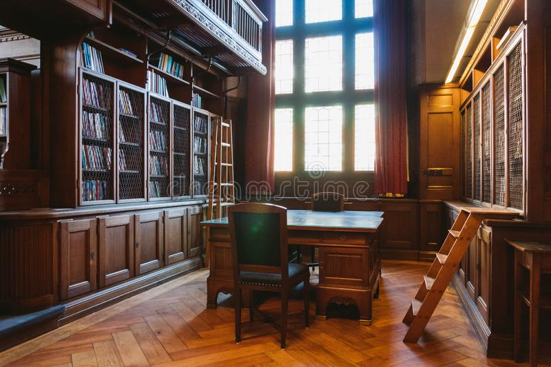 Storage of books. Large old library in the Gothic style. Shelves and rows with books. City Library at the City Hall of Denmark royalty free stock photos