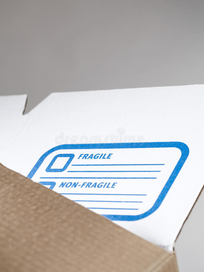 Storage Box Label - Closeup. Detail image of a storage box with a label for description and fragile marking stock images